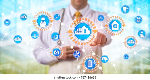 Unrecognizable male physician accessing electronic medical records via a network based on cloud container applications. Healthcare IT concept for cloud computing, containerization and micro services.