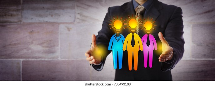 Unrecognizable male recruiter is forming a work team of three bright candidates. Human resources metaphor for team building, inspiration, staffing solution, entrepreneurship and talent management.