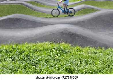 Unrecognizable man riding bicycles on pump track. Real people. Copy space