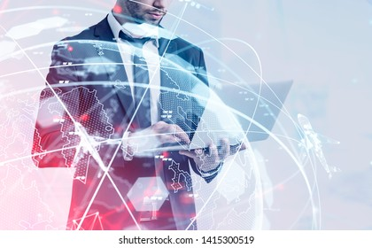 Unrecognizable man in suit standing with laptop with double exposure of globe and flying planes hologram. Concept of international transportation and logistics. Toned image