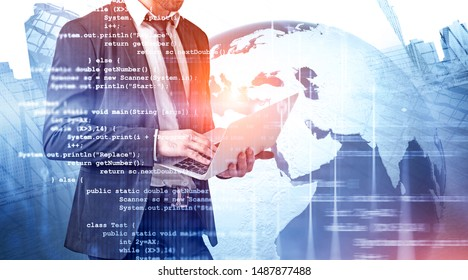 Unrecognizable man using laptop in city with double exposure of lines of code and planet hologram. Concept of programming. Toned image. Elements of this image furnished by NASA