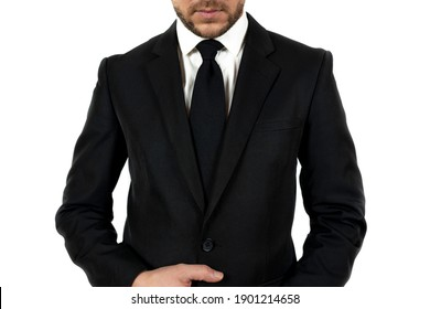 An unrecognizable man wearing a suit and posing on a white background