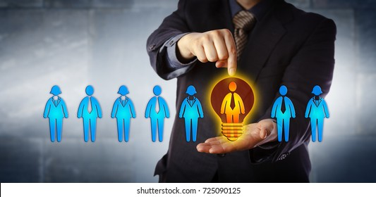 Unrecognizable manager appointing the ideal candidate from a lineup of four male and four female workers. Business concept for talent acquisition, coaching, promotion and performance evaluation.