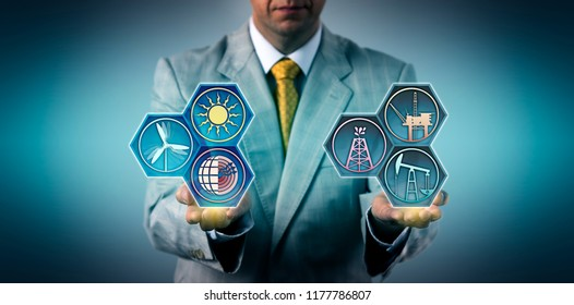 Unrecognizable manager is comparing fossil fuels and renewable energy resources. Industry and business concept for management of power generation sectors, sustainability, Energiewende, transition.