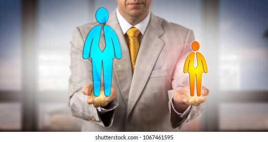 Unrecognizable manager comparing a small and a big male worker in his hands. Concept for challenge, David versus Goliath, inequality, potential, succession planning, competition, favoritism, protege.