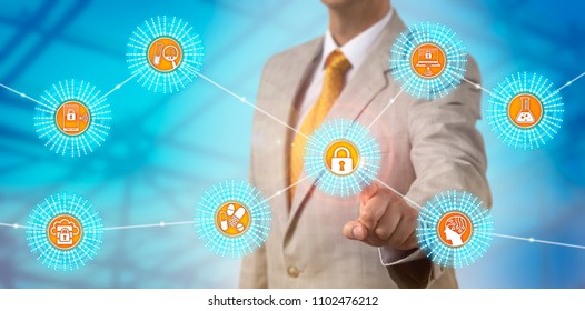 Unrecognizable IT manager erecting security perimeters around pharmaceutical data and bring your own device tools. Cybersecurity concept for pharma data security compliance and encrypted sessions.