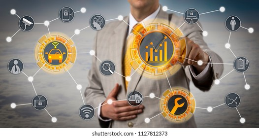 Unrecognizable manager using automotive telematics to monitor vehicle diagnostic. Technology concept for smart maintenance service, connected autonomous car, digital mobility, connectivity, AI.
