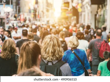 Unrecognizable mass of people walking in the city