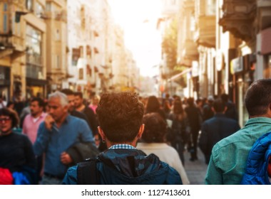 Unrecognizable mass of people walking in the street of the city
