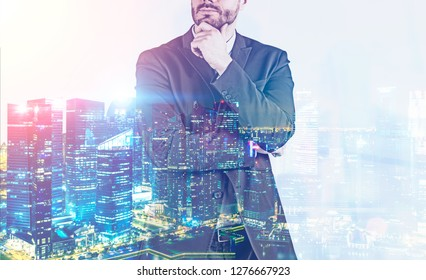 Unrecognizable pensive businessman portrait over night cityscape background. Concept of decision making. Toned image double exposure