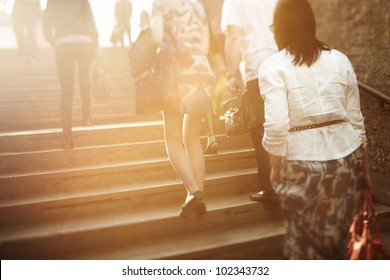 unrecognizable people are blurred with a tilt-shift lens, natural sunlight