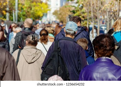 Unrecognizable people. Crowd of people walking on street sidewalk. View from the back. Concept of street and crowd.