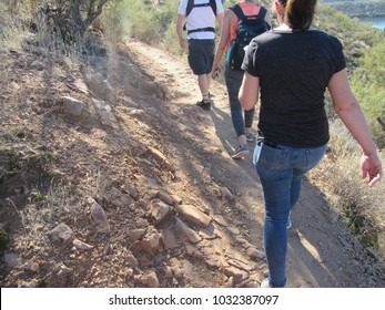 Unrecognizable people hiking by Saguaro Lake in Arizona