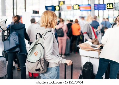 Unrecognizable people, a view from the back, a queue at the airport for check-in.