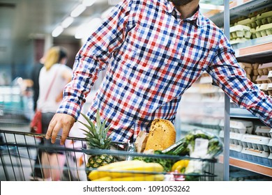 Unrecognizable person buying eggs in a supermarket. Front view. Horizontal.