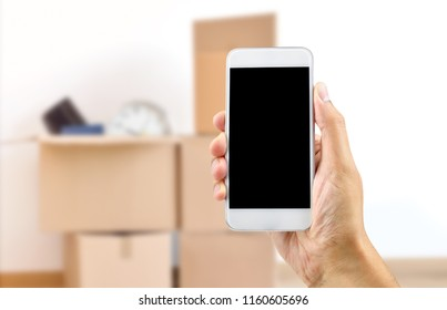 Unrecognizable person moving house and using an app on a cell phone