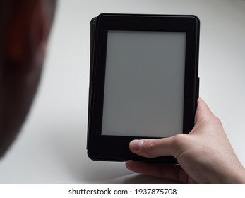Unrecognizable person reading electronic book with copy space