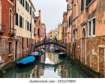 Unrecognizable person walking on a bridge in Venice, Italy