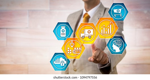 Unrecognizable pharmaceutical logistician activating icons for predictive analytics, materials handling and transportation. IT concept for supply chain management and pharma business logistics.