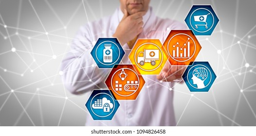 Unrecognizable pharmaceutical research scientist managing prescription drug supply chain via touch screen. Pharma IT concept for SCM, end-to-end fulfillment, serial tracking, freight transportation.