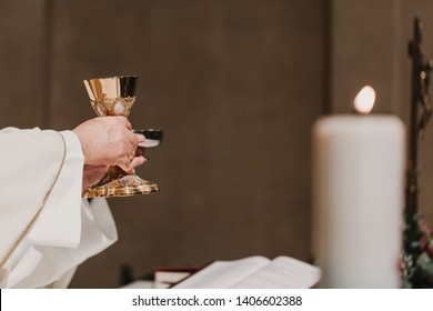 unrecognizable Priest holding the goblet during a wedding ceremony nuptial mass. Religion concept