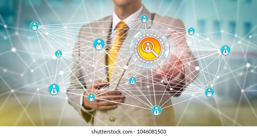 Unrecognizable recruitment agent finding a male candidate via a peer-to-peer network application. Human resources and information technology concept for talent acquisition, professional networking.