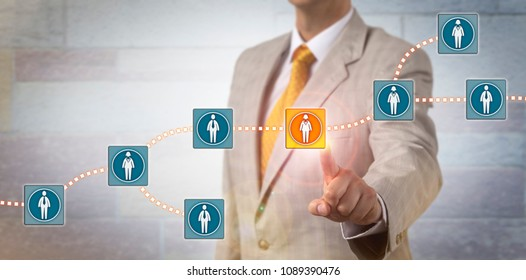 Unrecognizable recruitment agent selecting a female candidate data block in a blockchain system. Information technology concept for data management via distributed ledger in a peer to peer network.
