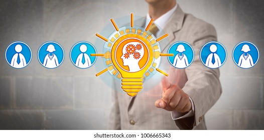 Unrecognizable recruitment manager selecting well performing bright brain inside a lightbulb in a lineup of candidates. Concept for work transformation, white collar automation, career development.