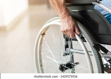 Unrecognizable senior person sitting in wheelchair