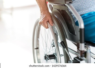 Unrecognizable senior person sitting in wheelchair
