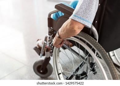 Unrecognizable senior woman sitting in her wheelchair