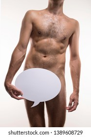 Unrecognizable skinny athletic young man holding blank white board, nakedness or male health concept. Blank speech bubble