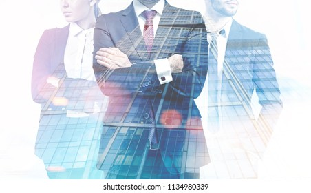 Unrecognizable successful business leaders. A foggy city background. Concept of business team. Toned image double exposure mock up.