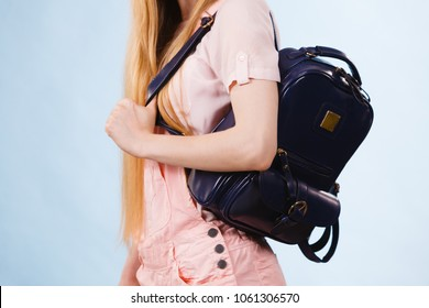 Unrecognizable teenage girl going to school or college wearing black stylish backpack. Outfit trendy accessories.