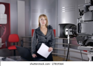 unrecognizable television news reporter in front of the video camera in studio