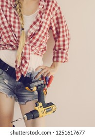 Unrecognizable woman with DIY toolbelt. Girl working at flat remodeling. Building, repair and renovation.