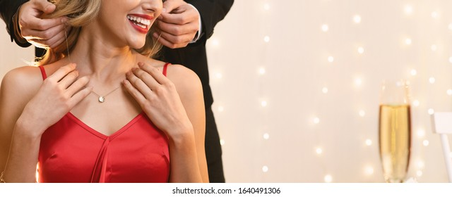 Unrecognizable Woman Getting Golden Necklace From Her Boyfriend For Valentine's Day During Romantic Dinner In Restaurant, Panorama With Free Space