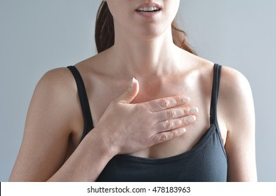 Unrecognizable woman having acute pain in a her chest . Close up of young female. Woman health care and medical illness. Real people. Copy space