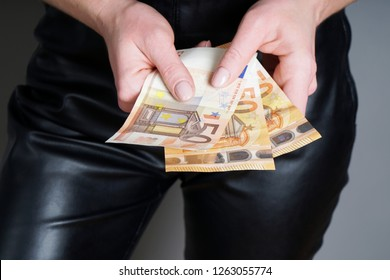 unrecognizable woman holding three fifty euro banknotes or bills in her hands - 150 euros as cash payment