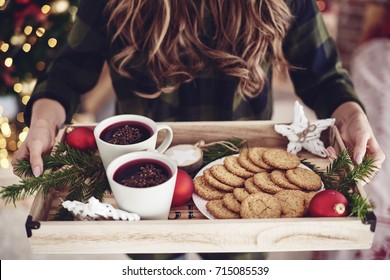 Unrecognizable woman holding tray with snack