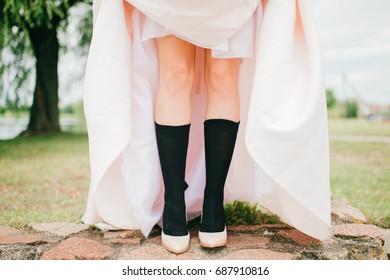 26c0cd793b4 Unrecognizable woman legs in men black socks and high heels shoes. Unknown  odd strange bride