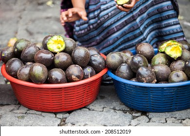An unrecognizable woman sells avocado fruit at traditional weekly market in Chichicastenango (Chichi), Guatemala.
