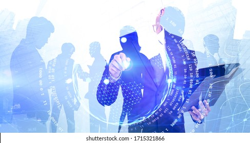 Unrecognizable young businessman with clipboard working with network hologram in city with his business team in background. Concept of technology and internet. Toned image double exposure