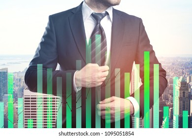Unrecognizable young businessman on abstract city office background with forex chart. Trade, investment and profit concept. Double exposure