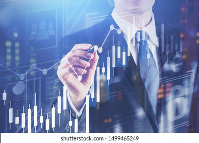 Unrecognizable young businessman working with digital graph over blurred night city background. Concept of stock market and technology. Toned image double exposure