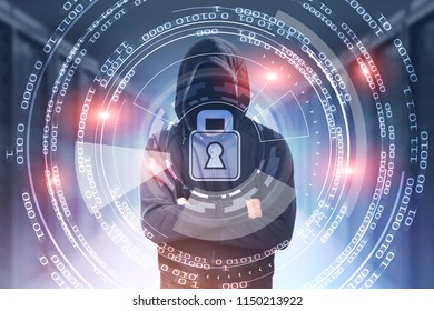 Unrecognizable young hacker in a black hoodie standing crossed arms against blurred server room background. Circles of zeros and ones. Concept of cyber security. Toned image double exposure