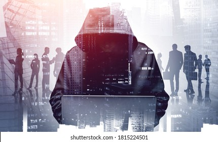 Unrecognizable young hacker in hoodie using laptop in blurry city. Business people. Concept of cybersecurity. Toned image double expsoure