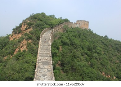 An Unrestored Section of the Great Wall through Steep Mountains