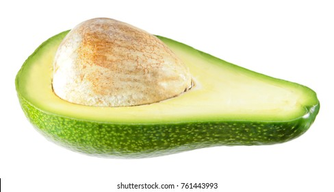 Unripe Green avocado fruit cut in half inside longitudinal section isolated on white background