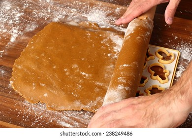 Unroll dough on cutting sheet. Making Christmas Gingerbread Cookies